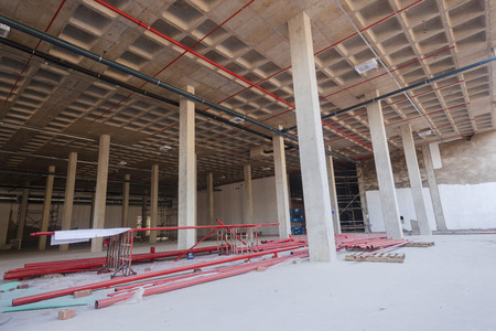 Construction installation high pressure fire water pipes midway into new building Stock Photo - 44806413