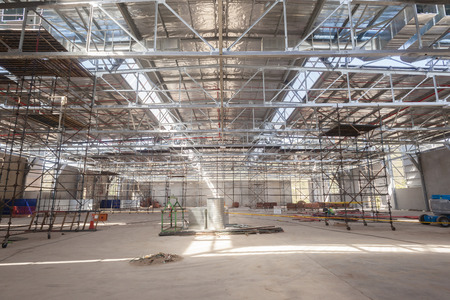 warehouse building: Building warehouse inside new bolted beams steel framework structures midway installations
