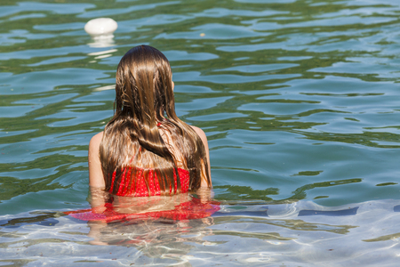 pool preteen: Young girl relaxing swimming pool water Stock Photo