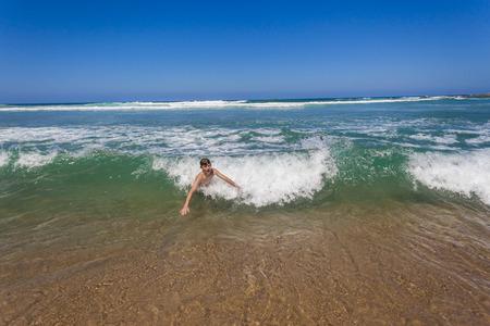 shorebreak: Teenager boy swim body surfing beach shorebreak  ocean wave holiday landscape