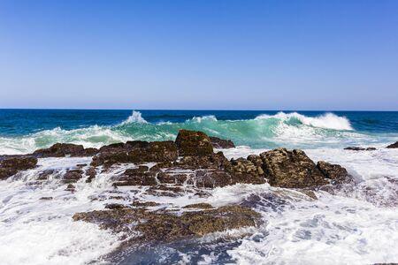 rocky coastline: Ocean wave crashing rocky coastline  water power