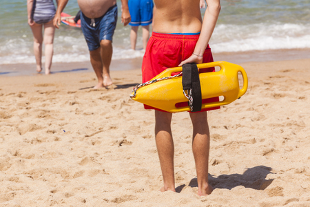 safety buoy: Lifeguard rear with safety rescue swimming buoy