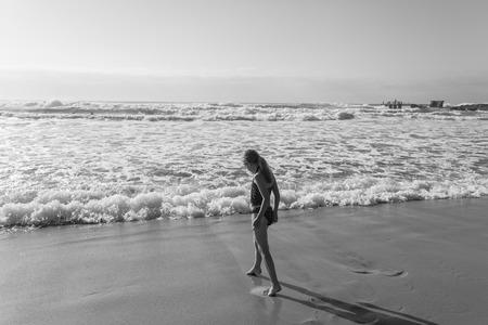 swimming at the beach: Girl preteen beach waterline summer morning ocean swim