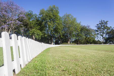 cricket field: Cricket field boundary fence summer sport setting landscape