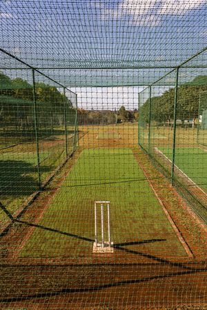 batting: Cricket practice batting bowling nets with astro turf pitch .