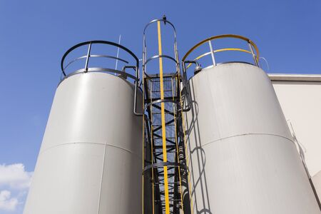 liquids: Industrial chemical liquids steel storage tanks outdoors Stock Photo