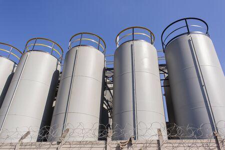 liquids: Industrial chemicals liquids  steel storage tanks outdoors
