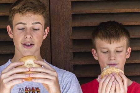 teen boys: Teen boys lunch fresh bread roll sandwich