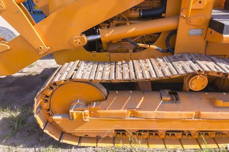 grader: Industrial earthworks grader machine closeup detail hydraulic power piston ram equipment Stock Photo