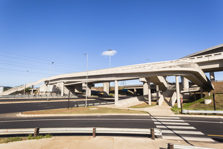 New road highway junction inter section flyover ramps pedestrian structures complete for fast vehicle traffic flow Stock Photo