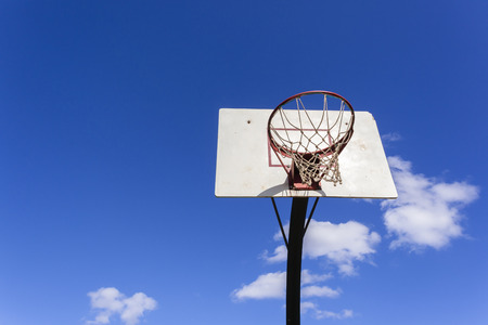 Basketball court net hoop ring board outside blue sky. Stock Photo