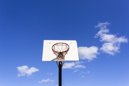 hoop: Basketball court net hoop ring board outside blue sky. Stock Photo