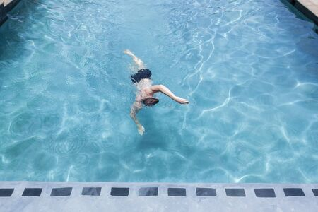 swimming pool home: Teen boy  swimming pool home fitness training summer