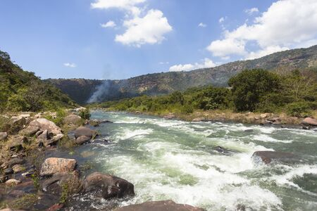 rapids: River water rapids through tropical valley landscape