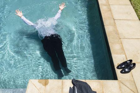swim shoes: Businessman underwater swimming pool