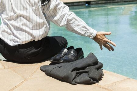 swimming shoes: Businessman closeup suit tie shirt shoes  timeout swimming pool summer.
