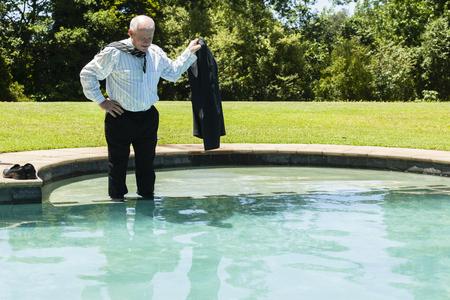 swim shoes: Businessman closeup suit tie shirt timeout swimming pool holidays