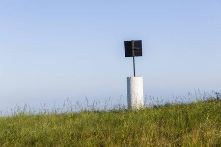 beacon: Beacon marker on rural hilltop countryside landscape
