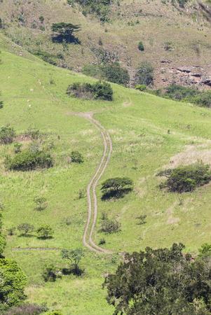 four wheeler: Steep four wheel dirt track vehicle path up and down steep hillside Stock Photo