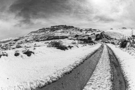 mud snow: Mountains Snow dirt road mud tracks vintage black white