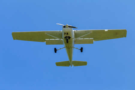 light aircraft: Plane light aircraft single prop flying overhead Stock Photo