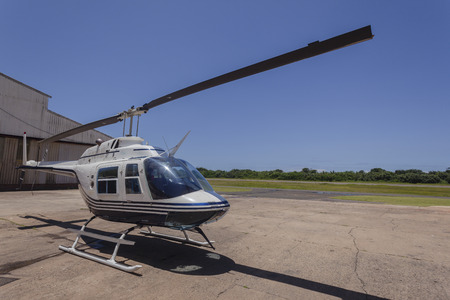 policing: Helicopter aircraft parked midday airport