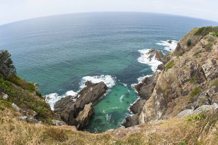blue waters: Ocean blue waters overlooking rocky cliffs landscape