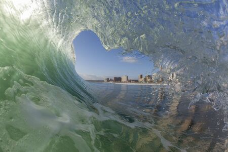 swells: Wave ocean swimming tube encounter wall of water crashing breaking beauty nature power.