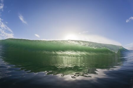 swells: Wave ocean swimming wall of water crashing breaking beauty nature power. Stock Photo