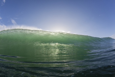 swells: Wave ocean swimming wall of water crashing breaking beauty of natures power. Stock Photo