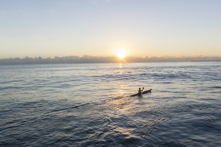 paddler: Paddler surf ski canoe ocean waters sunrise training