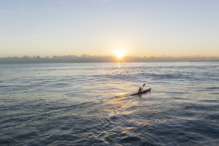 waters: Paddler surf ski canoe ocean waters sunrise training.
