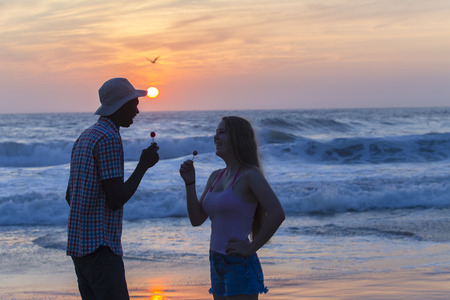 silhouetted: Friends man girl silhouetted talking conversation beach ocean sunrise lifestyle