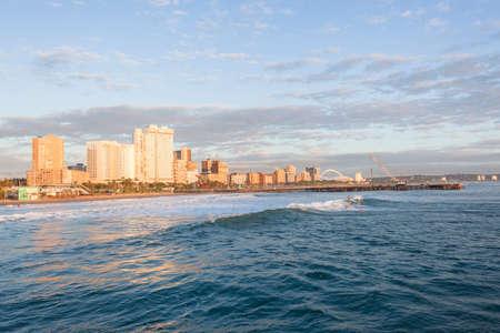 beachfront: Durban beachfront ocean surfing surfers early morning sports.