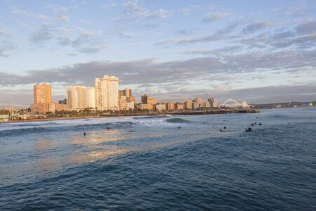 stadium  durban: Durban beachfront ocean surfing surfers early session Stock Photo