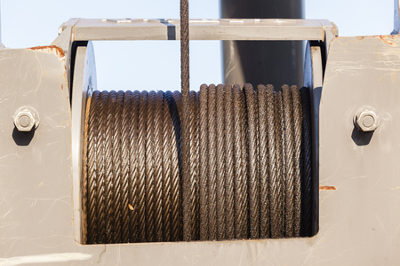 steel cable: Industrial crane steel cable length around pulley drum greased for protection and wear. Stock Photo