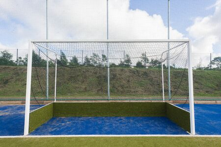 Hockey field astro turf surface new goals field nets.