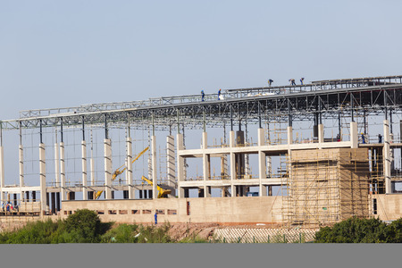 warehouse building: Warehouse factory building construction mid way with frame roofing metal structures been installed.