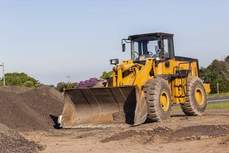 construction vehicle: Industrial grader vehicle bucket bin for earthworks construction .