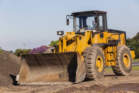 grader: Industrial grader vehicle and bucket bin for earthworks construction . Stock Photo