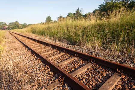 single line: Railway train single line steel tracks closeup detail in countryside.