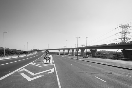 flyovers: Road highway junction structure for vehicle traffic flow in black and white Stock Photo