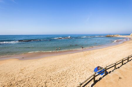 bathers: Beach ocean blue water rock tidal pool with holiday bathers swimming coastline landscape.