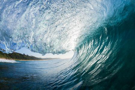 crashing: Ocean wave swimming inside hollow crashing surfing tube ride perspective.