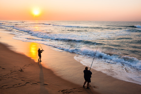 ocean fishing: Fishermen fishing beach ocean sunrise landscape