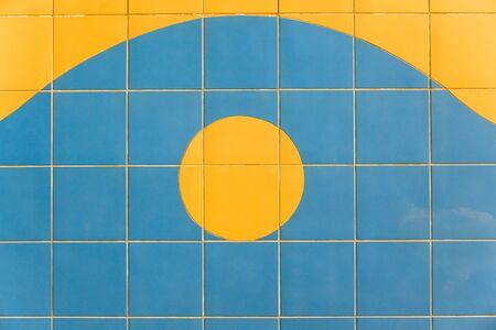 wall decor: Decor tiles yellow sun design blue wall.