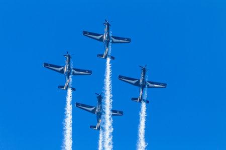 acrobatics: Aircraft acrobatics planes pilots in flying action.
