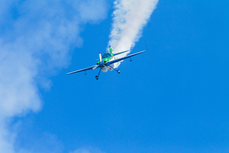 acrobatics: Aircraft acrobatics plane pilot in flying action. Editorial