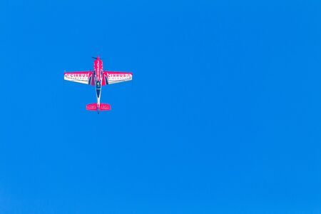 Aircraft acrobatics plane pilot in flying action.