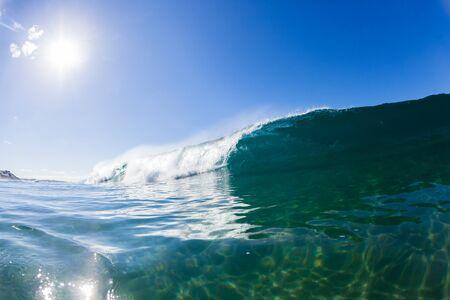 crashing: Wave inside hollow crashing blue ocean water swimming photo